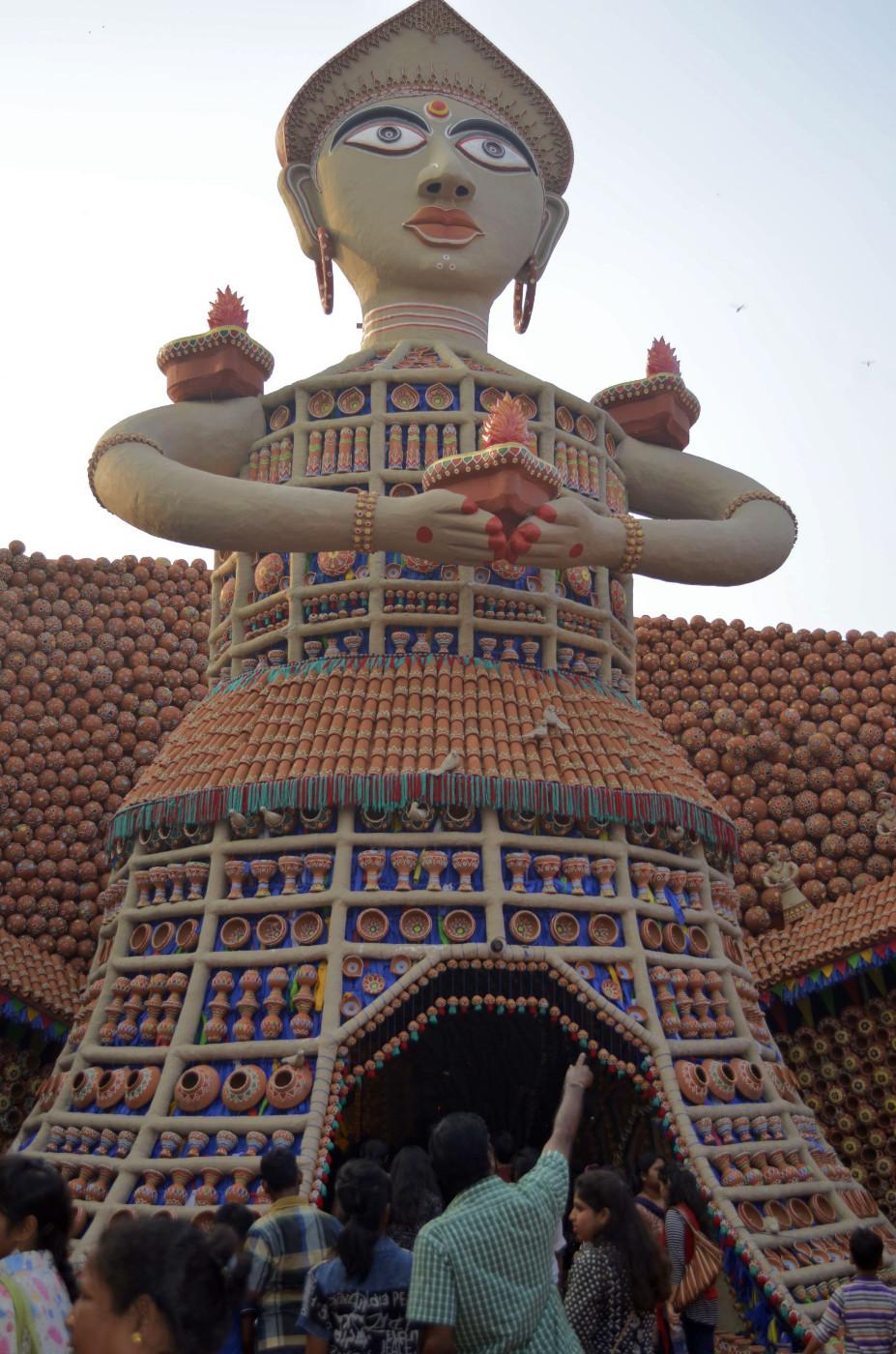 Welcome with clay lamp in hand, Kolkata Durga Puja 2015